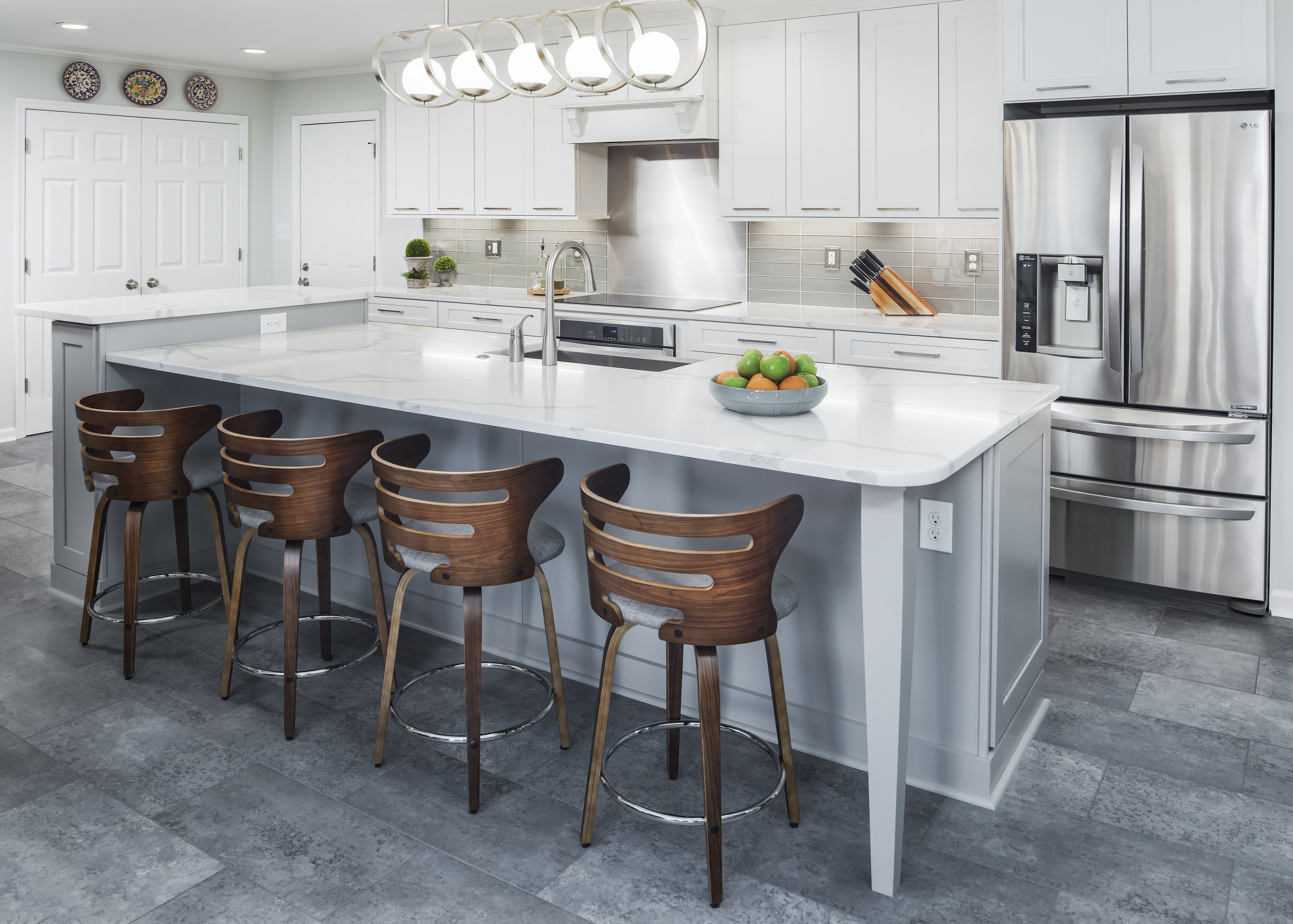 kitchen remodel with cabinets, pendant lighting, island, bar seating