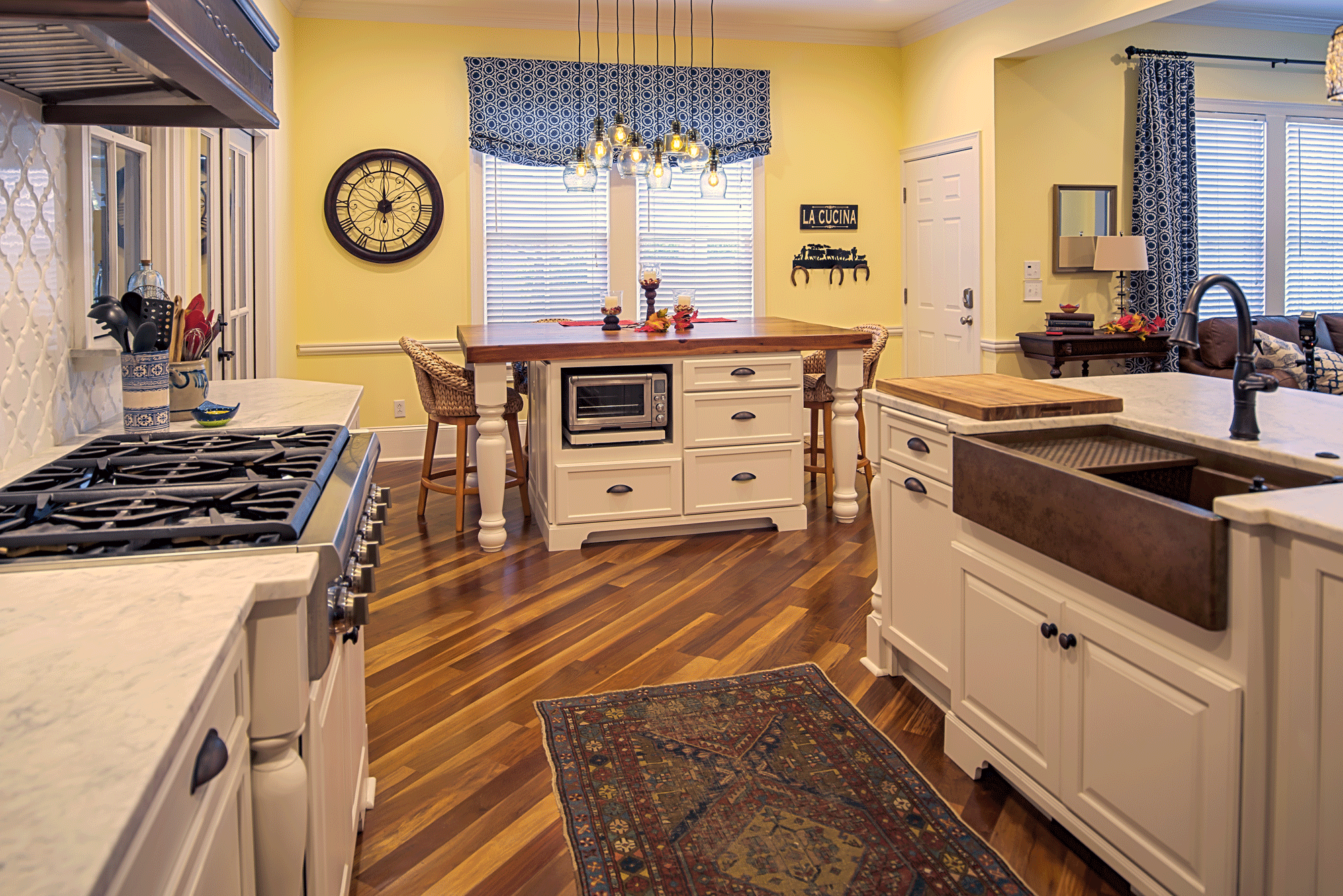 kitchen remodel with butcher block island, cabinets, bar seating, pendant lighting, decor