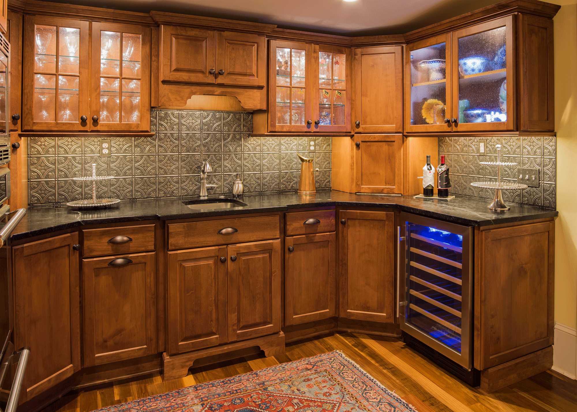 kitchen remodel with cabinetry, backsplash, and storage