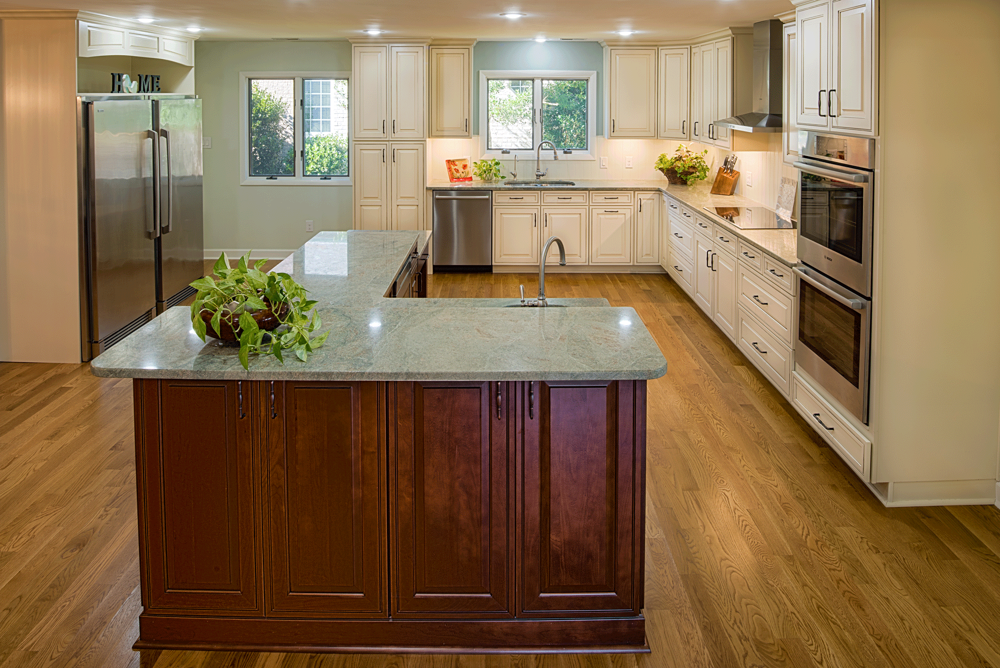 kitchen remodel with mixed cabinetry and decor