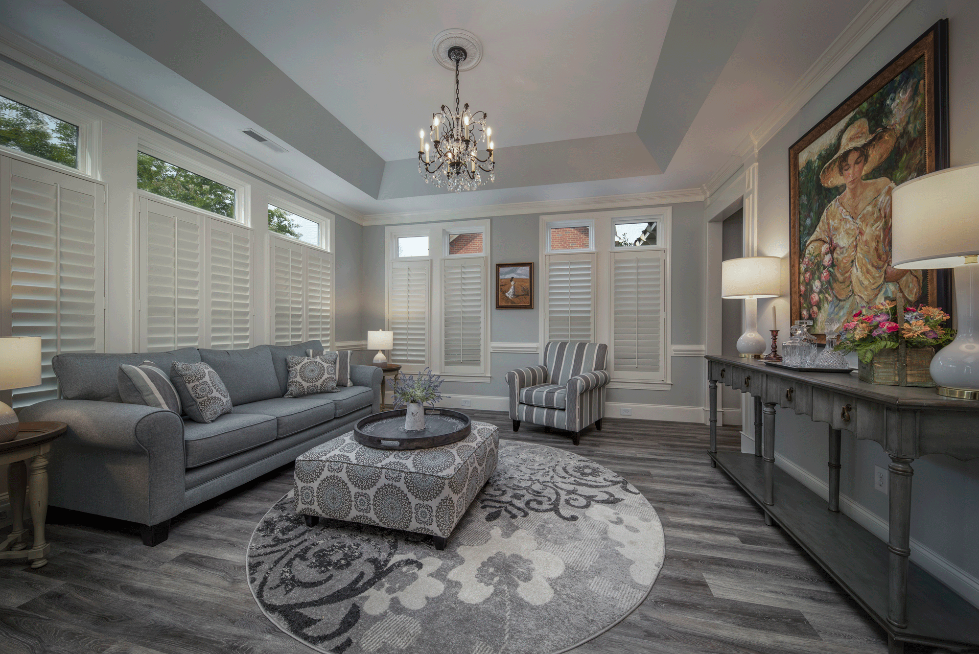 interior design for living room with flooring, furniture, seating, lighting, wall artwork, and decor