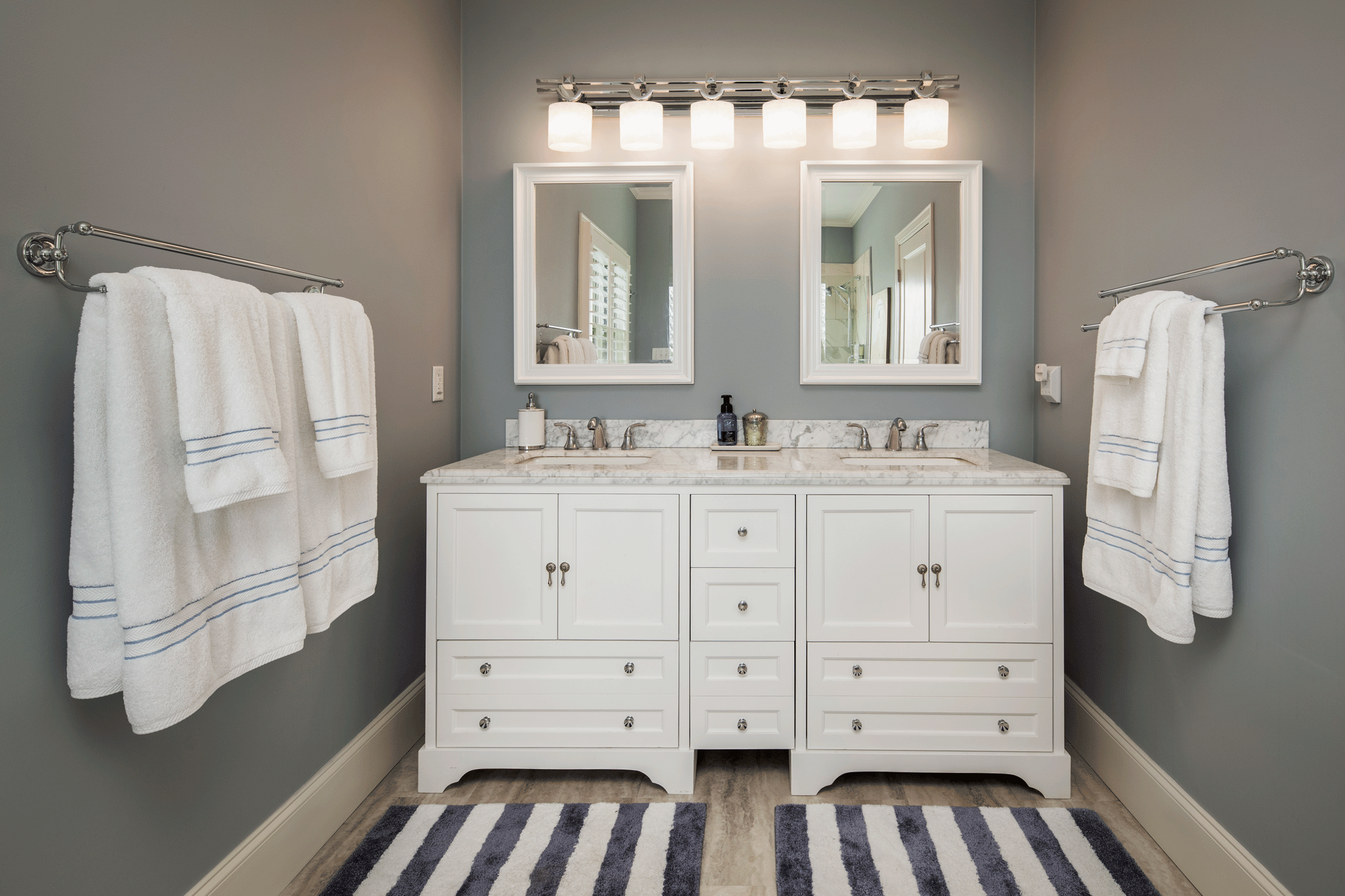 bathroom remodel with decor, cabinets, and lighting