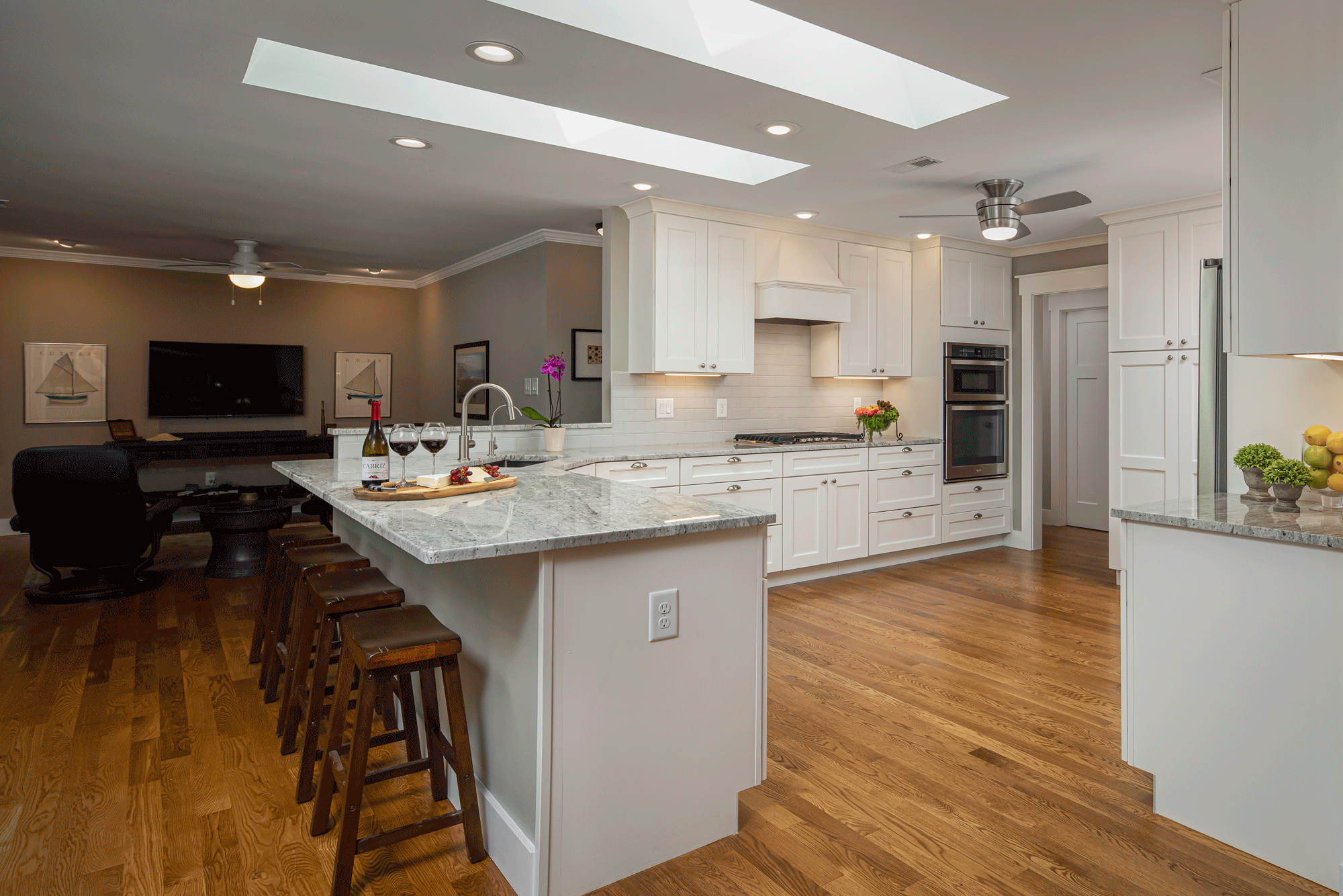 kitchen remodel with lighting, island, seating, and decor