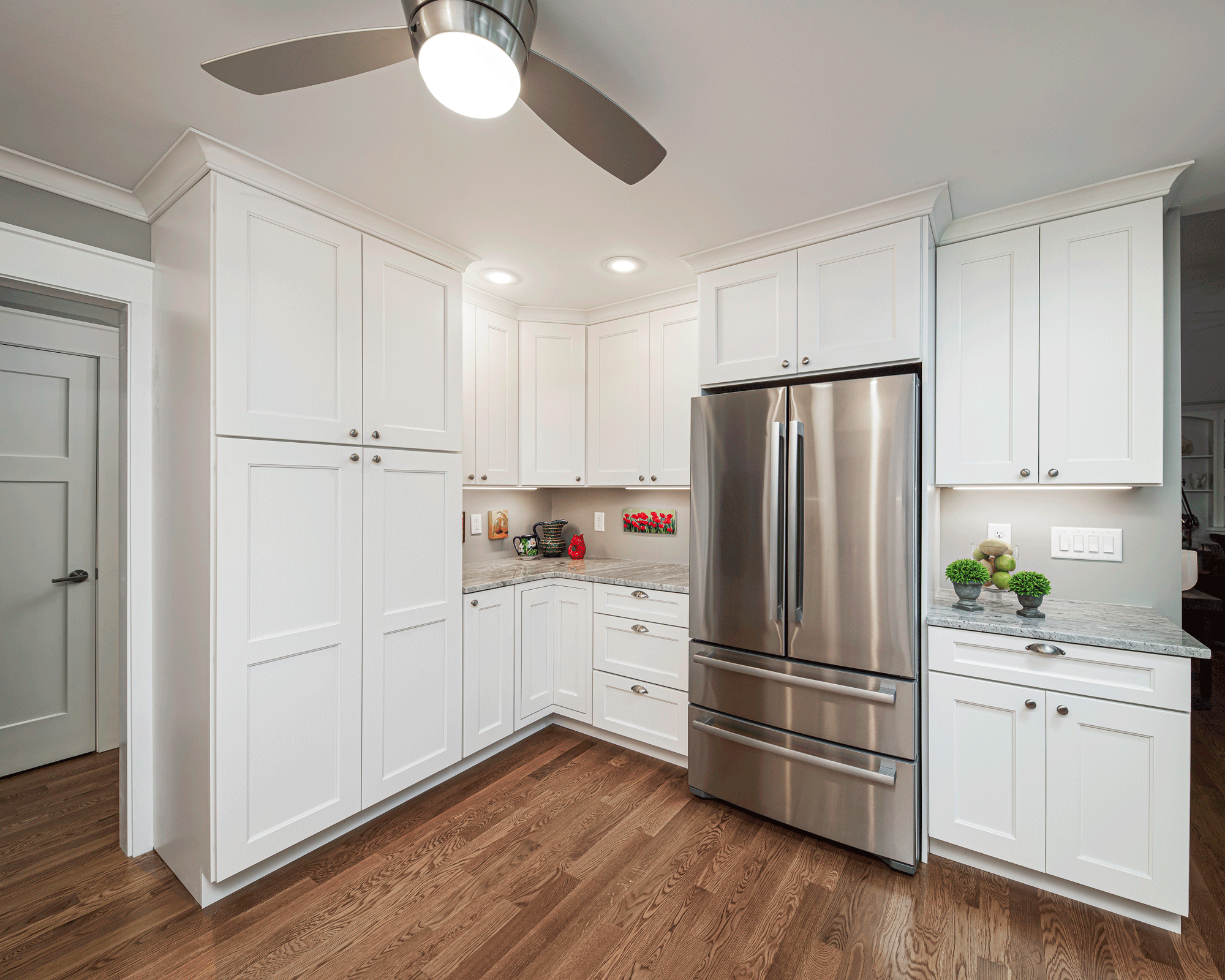 kitchen remodel with lighting, island, cabinets, seating, and decor