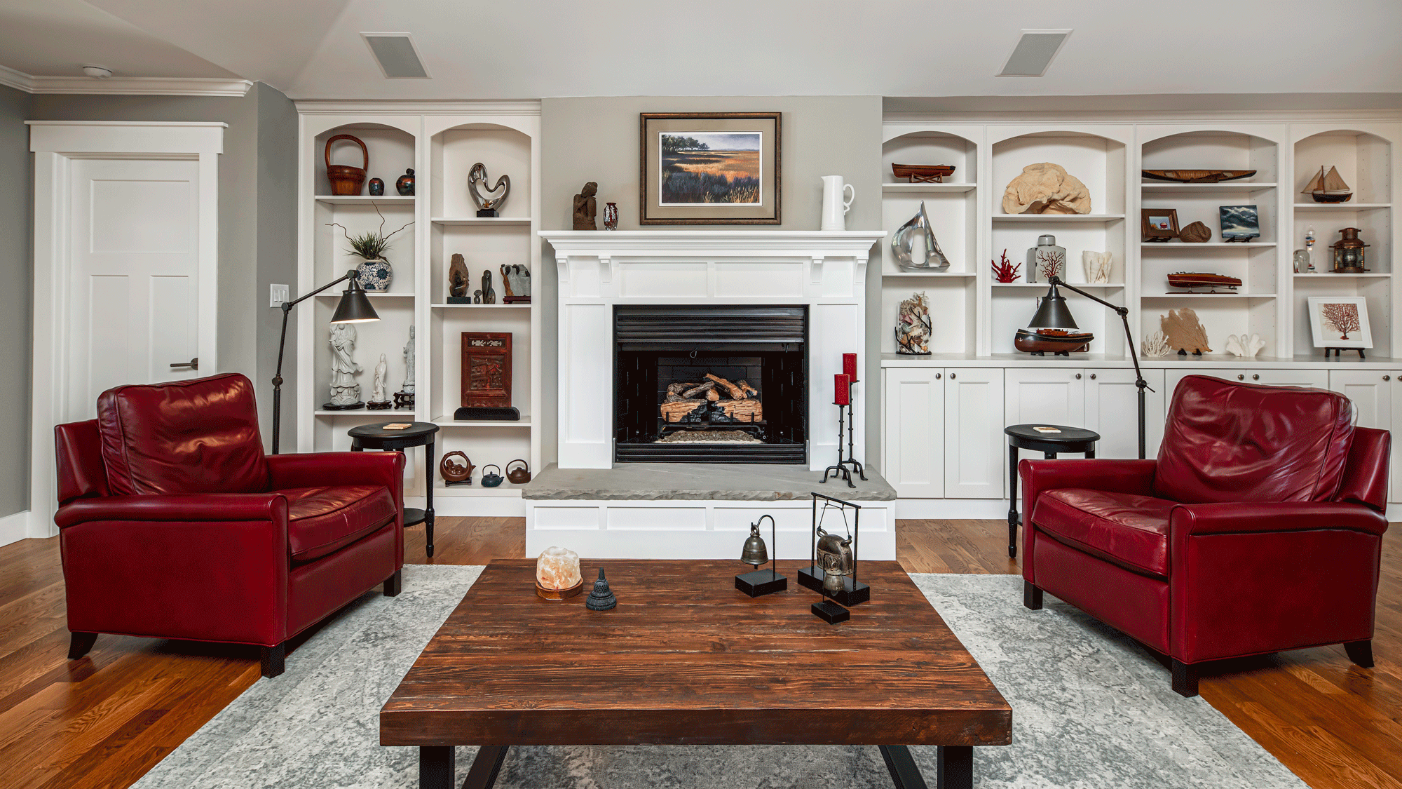 living room design with built in shelves, seating, decor