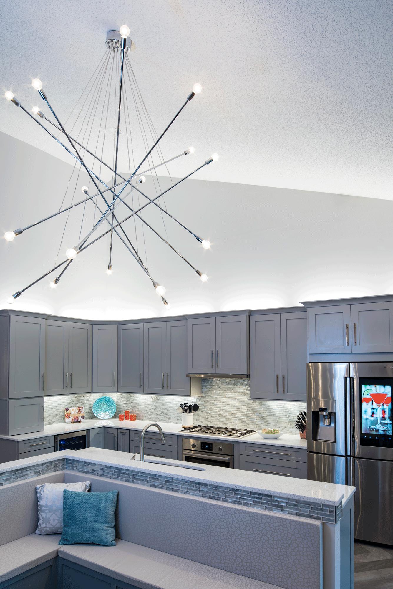 kitchen remodel with grey cabinets, unique creative lighting, tile backsplash