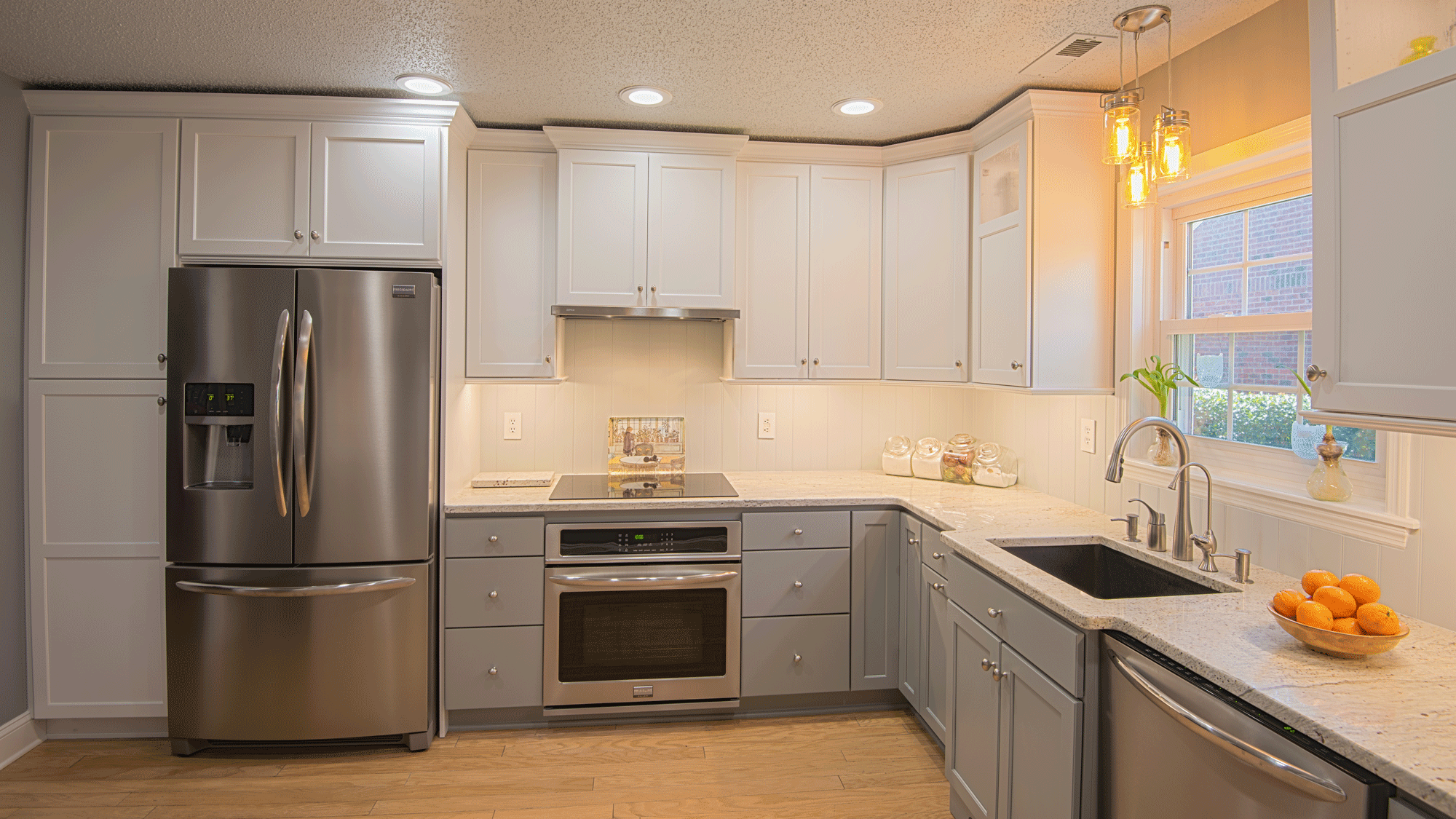 kitchen remodel with cabinets and recessed lighting