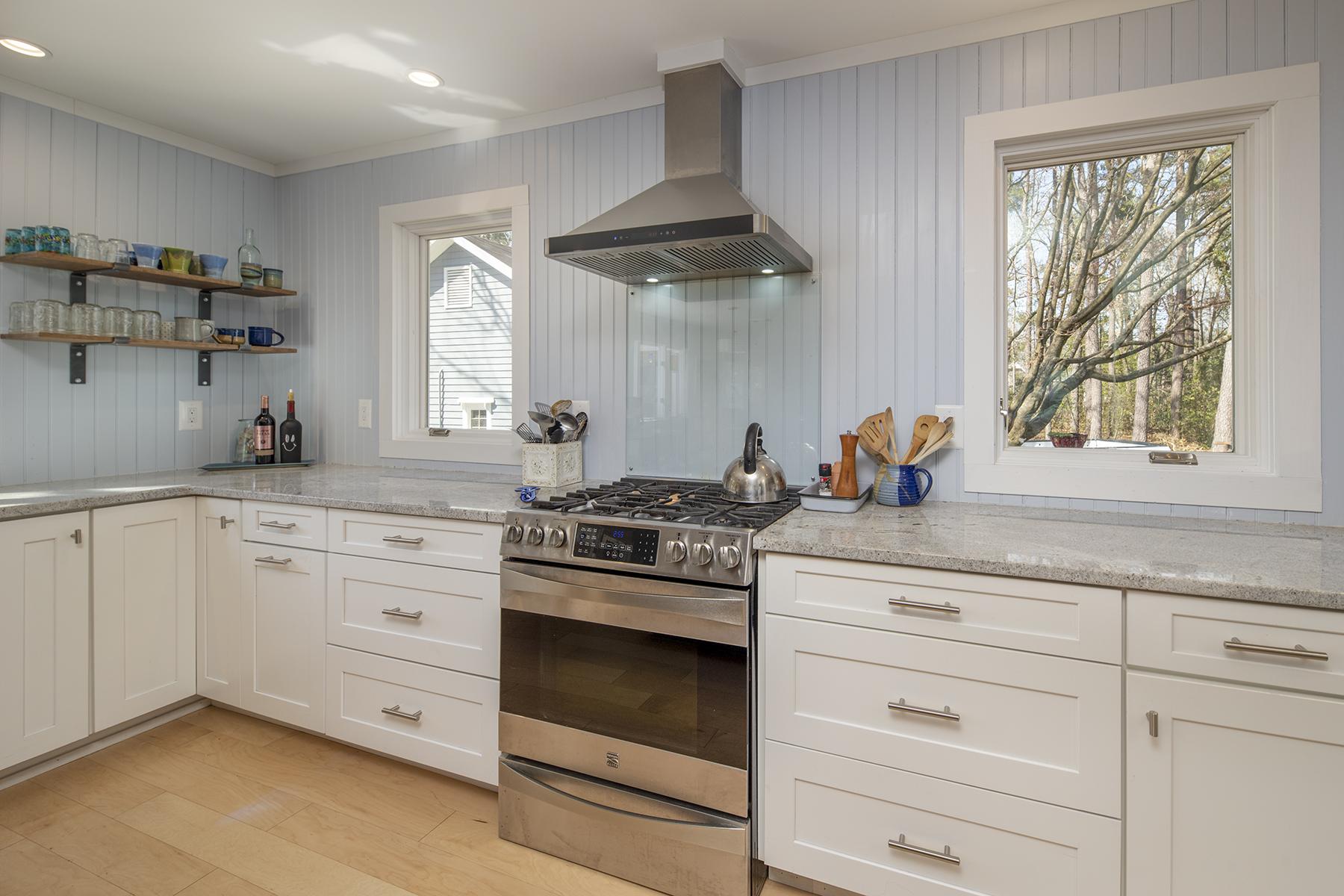 kitchen dining room remodel with tile backsplash, cabinets, pendant lighting, furniture, decor