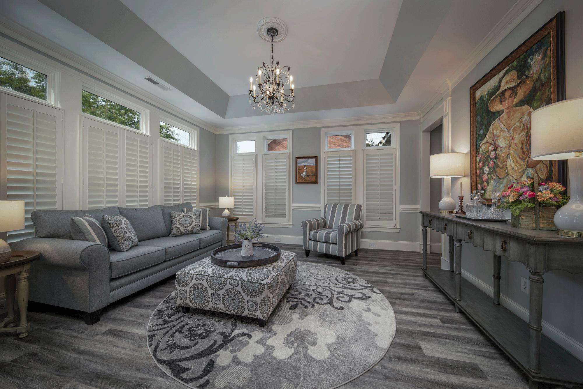 Living room design with furniture, decor, chandelier, artwork