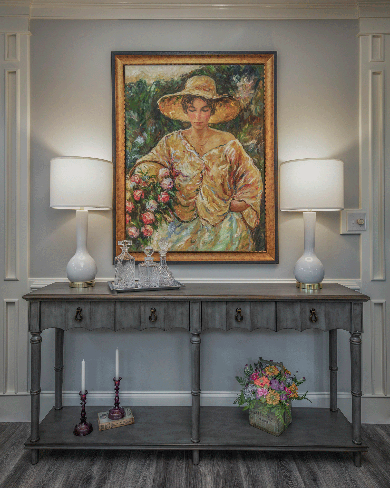 Console table with table lamps, decor, artwork, wainscoting decor