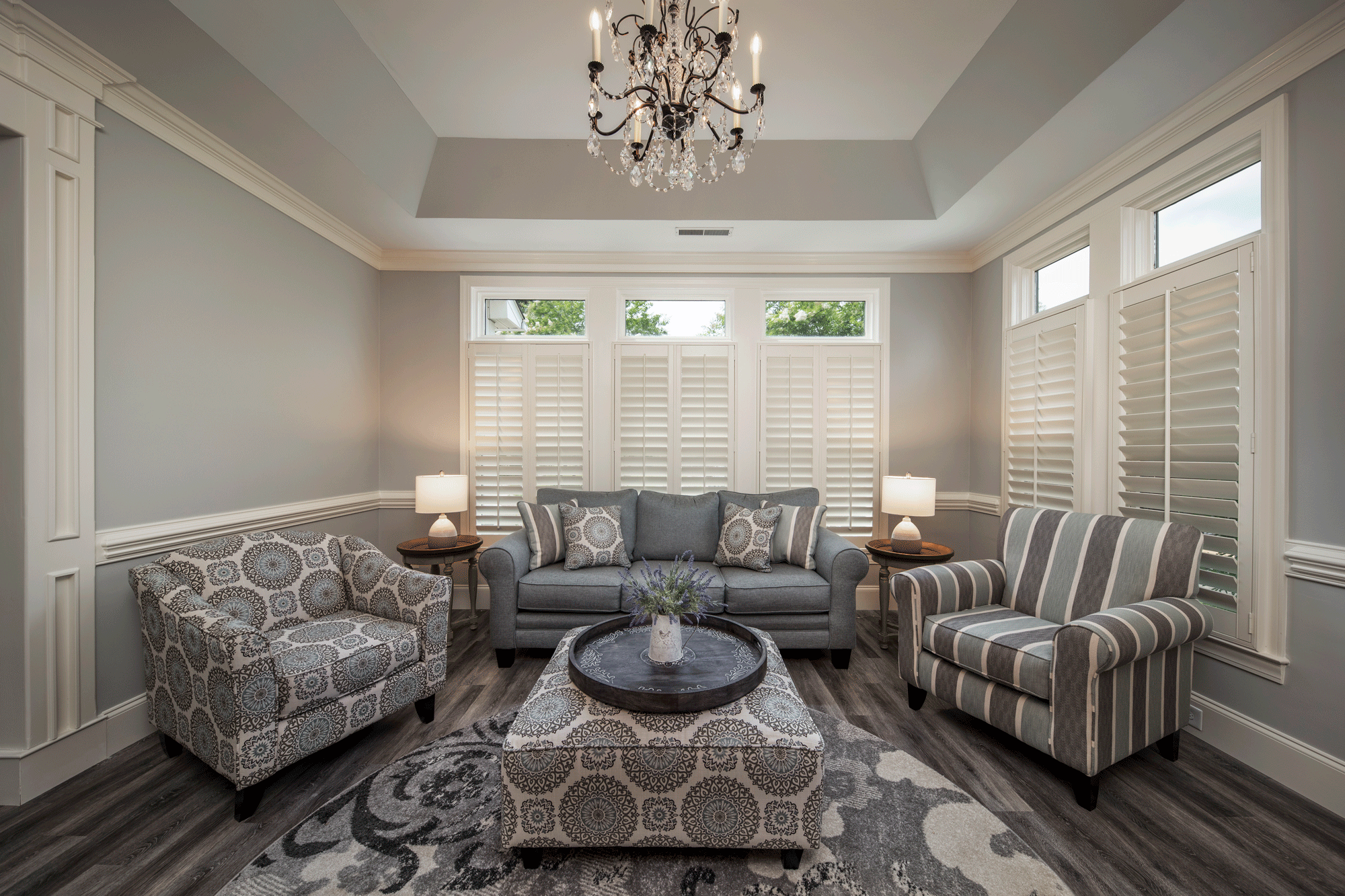 Living room design with furniture, seating, lighting, and wainscoting