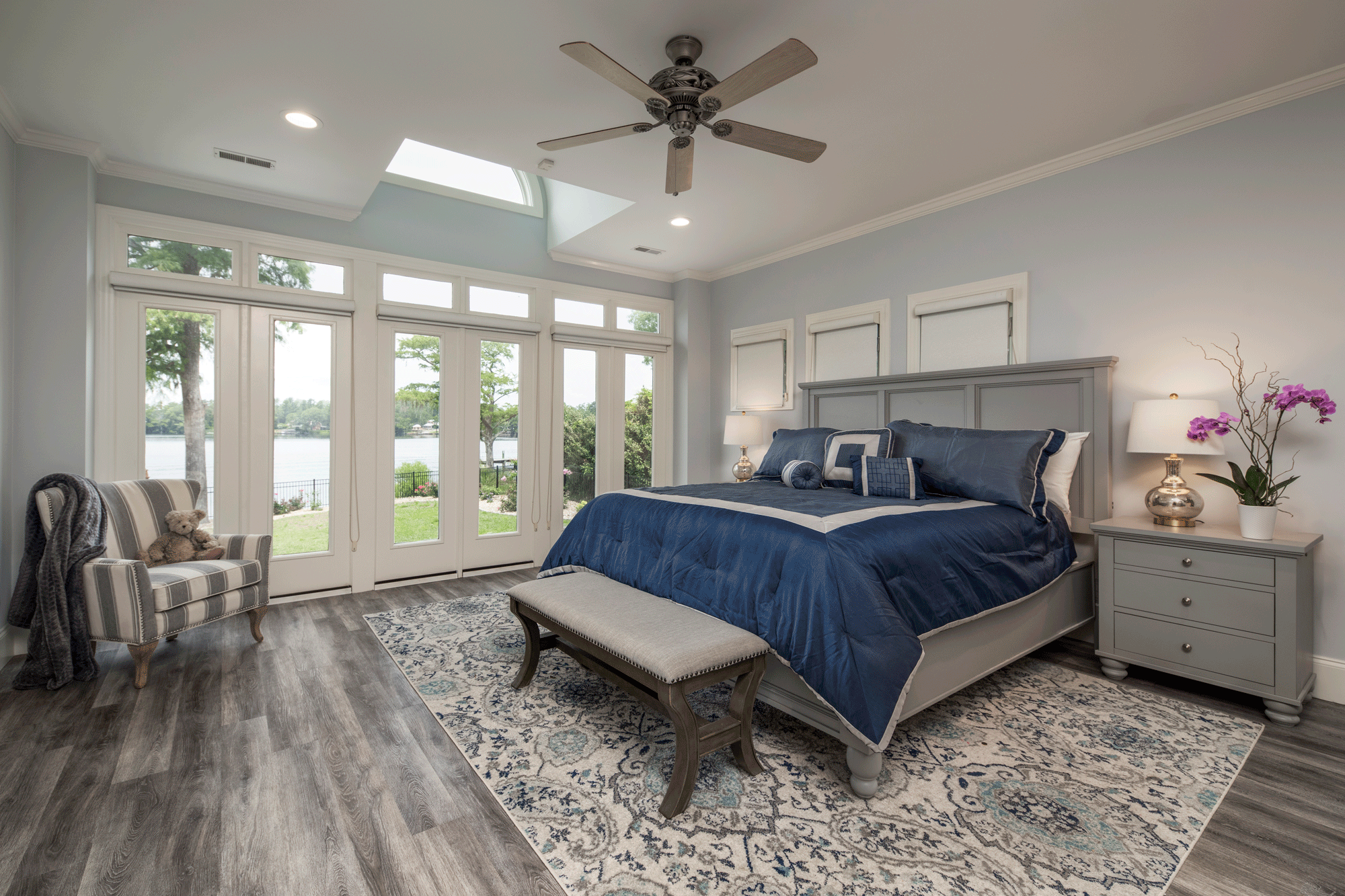 Bedroom design with decor, furniture, lighting, ceiling fan