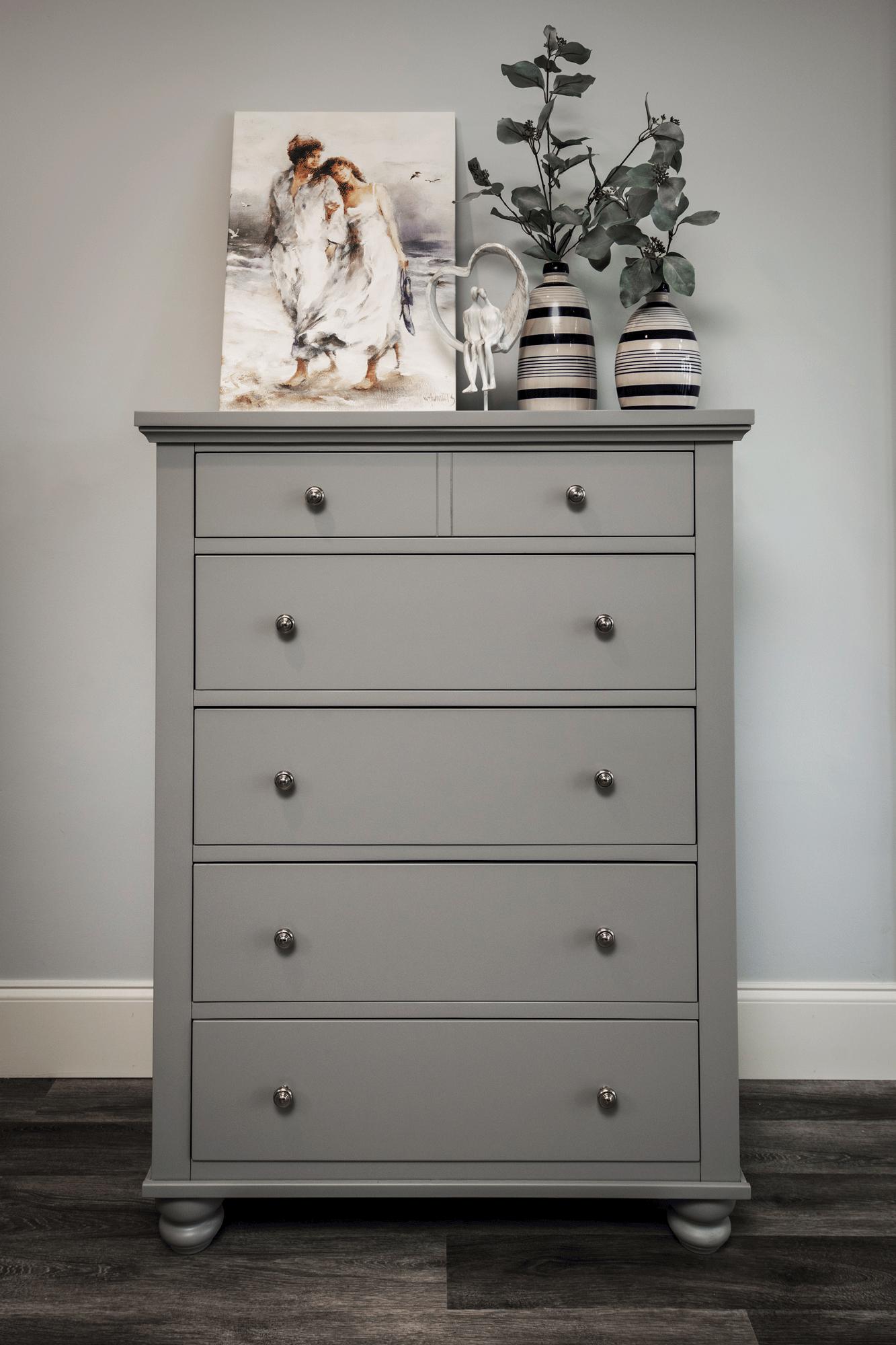 Bedroom decor with grey dresser