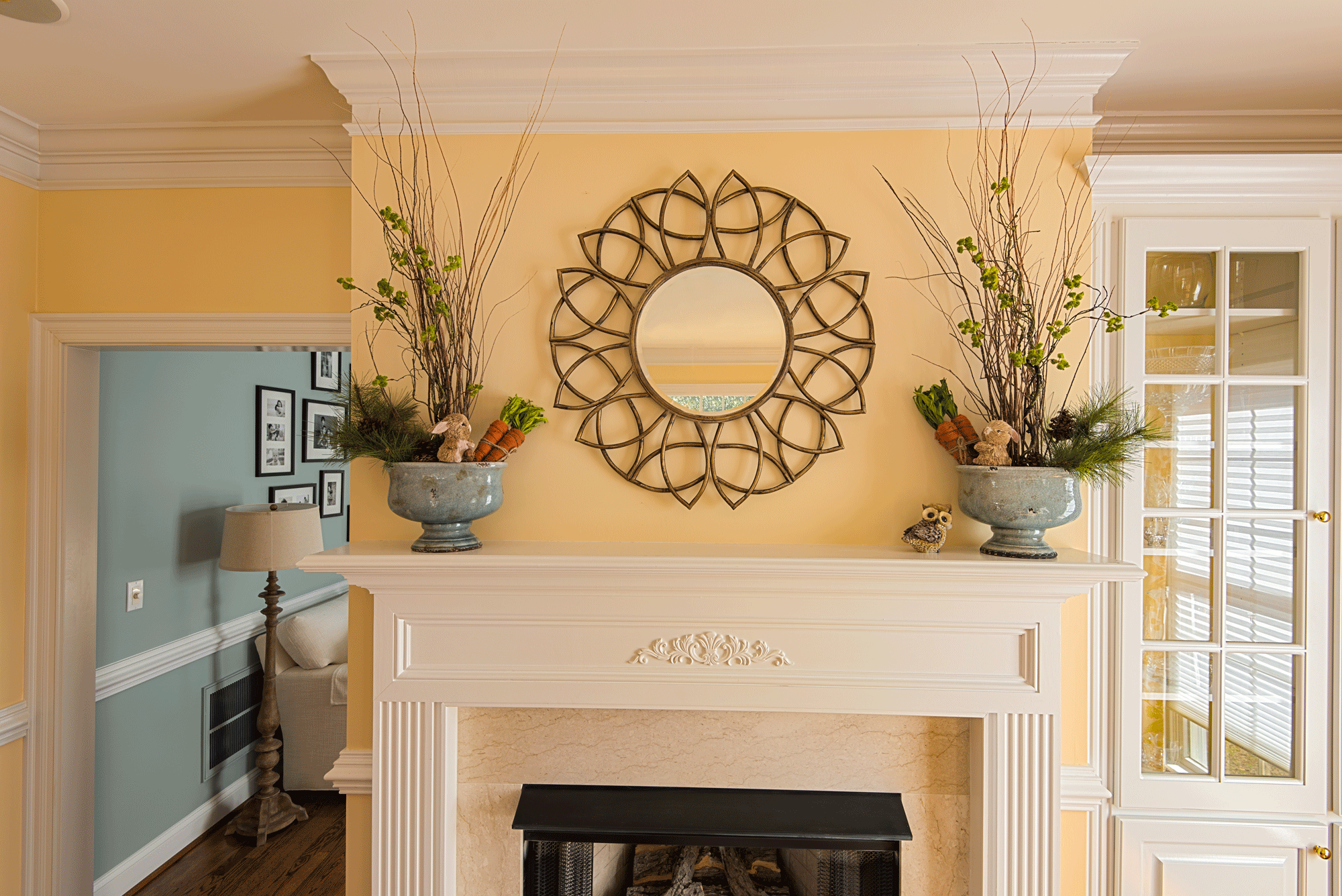 Mantle design and decor with mirror and plants