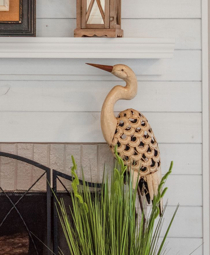 Mantle design with bird decor