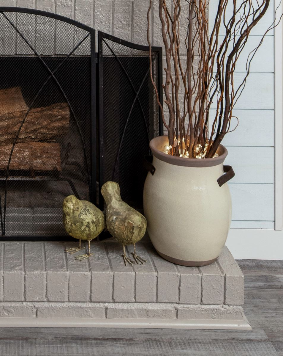 Fireplace decor with branches & birds
