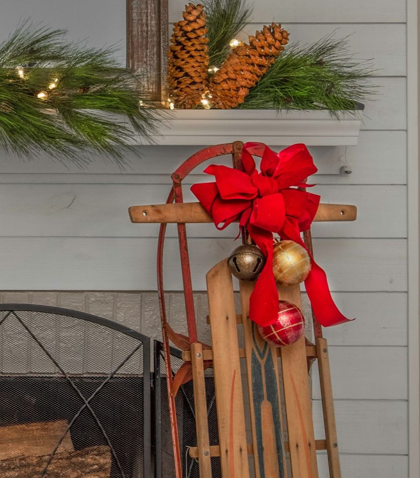 Fireplace decor with holiday pinecones and ornaments