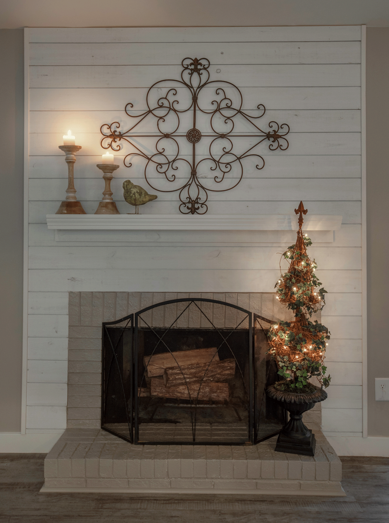 Fireplace mantle design with holiday tree and candles