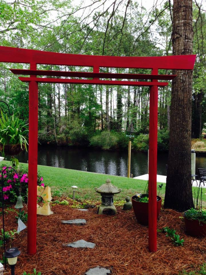 Landscape design with asian decor and walkway