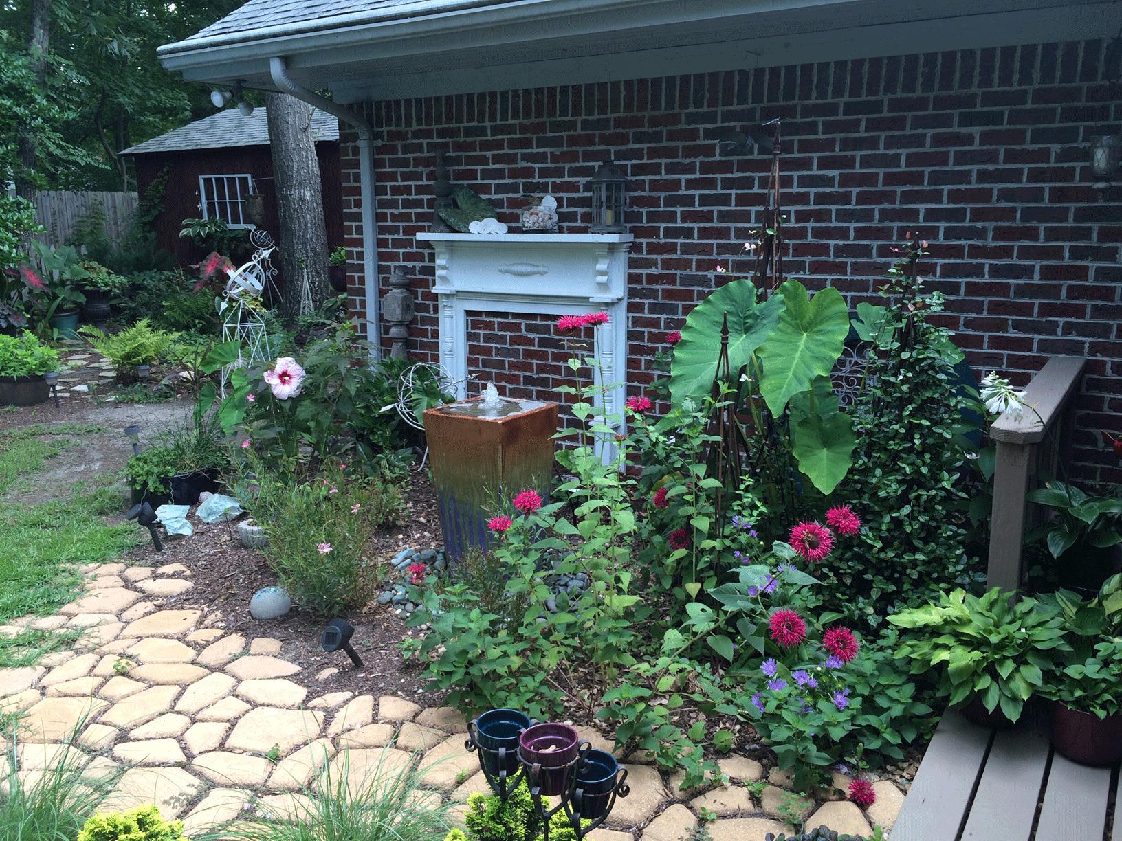 Landscape design garden with stone walkway