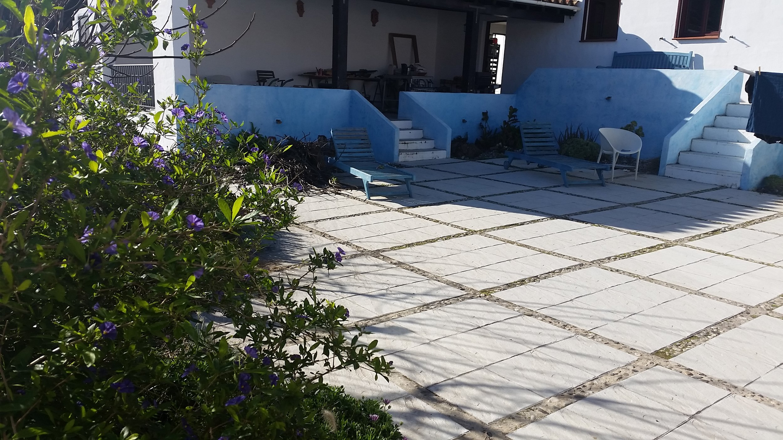 The courtyard and covered porch next to the casita