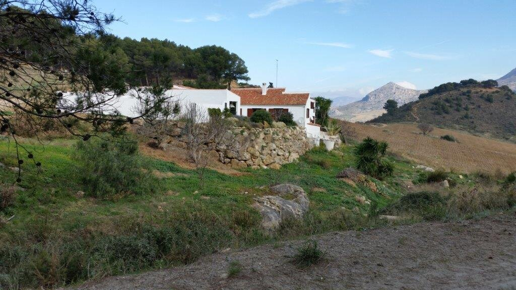 The house with the Sierra de las Nieves National Park behind