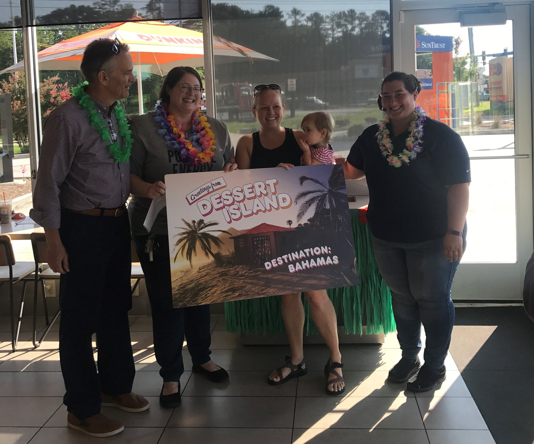 Bluemont Group presenting winner with the Dessert Island Give Away
