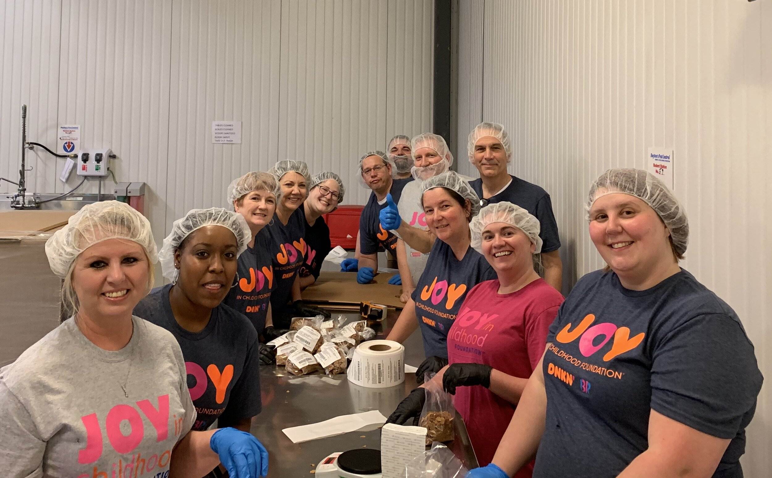 Bluemont leadership team volunteering at Maryville Second Harvest Food Bank