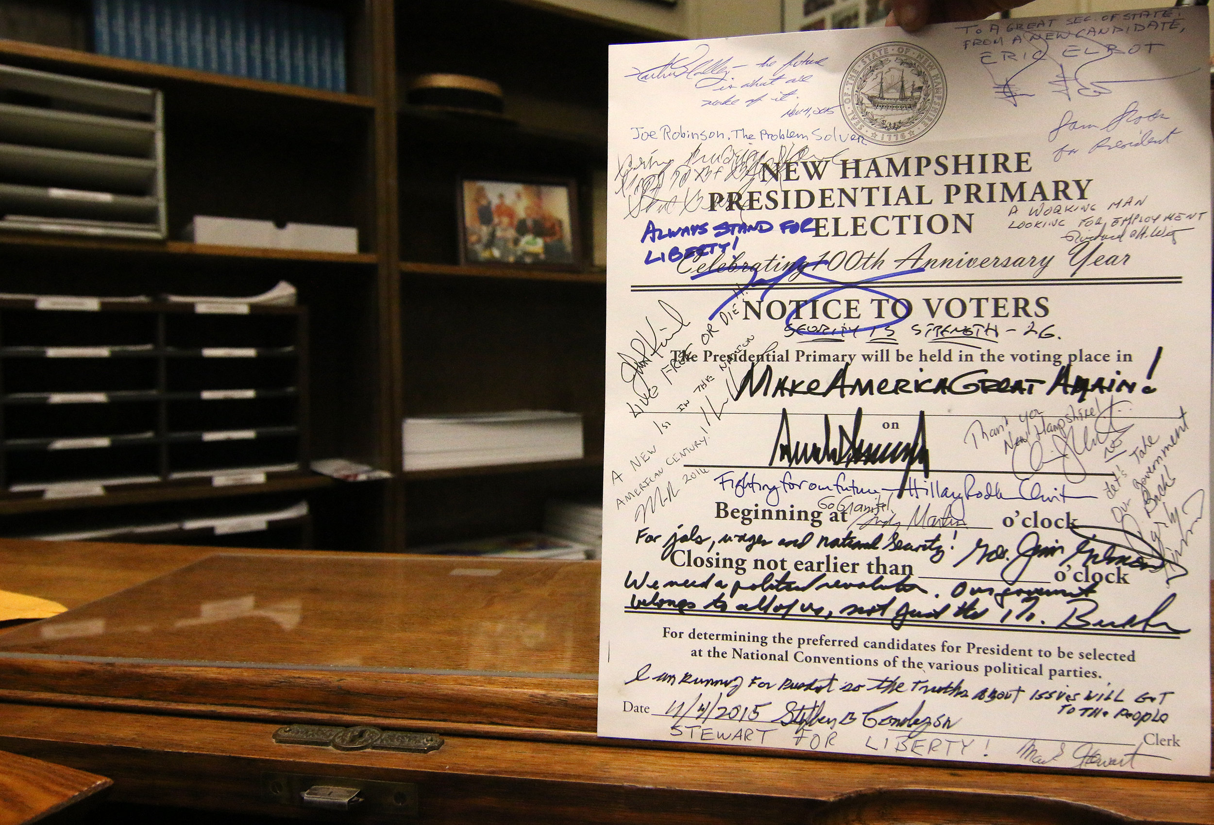 Gardner asks candidates filing for the New Hampshire Primary to sign this official notice. Photo by Allegra Boverman.