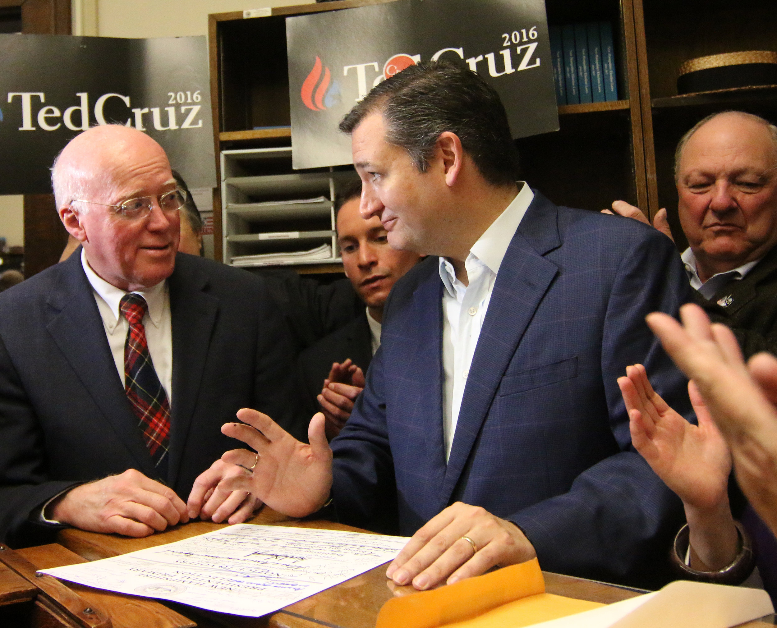 Texas Sen. Ted Cruz jokes with Gardner as he signs his filing papers for the 2016 New Hampshire Primary. Photo by Allegra Boverman.