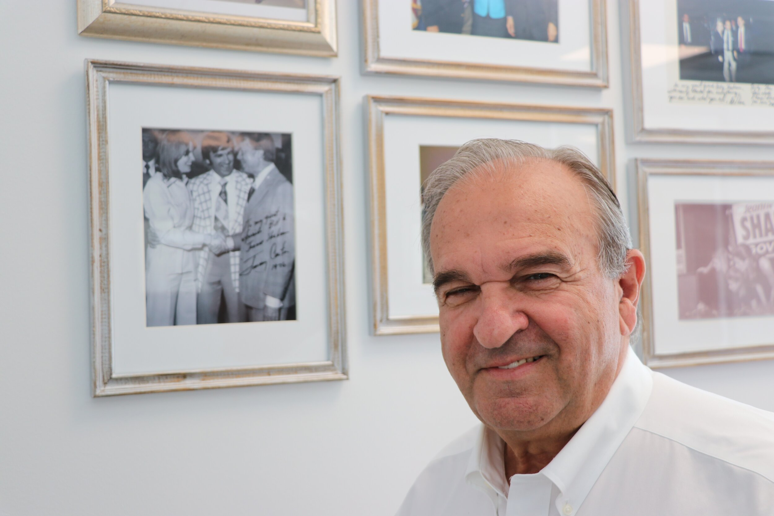 Billy Shaheen poses in front of his primary wall of fame. Photos by Dan Tuohy.