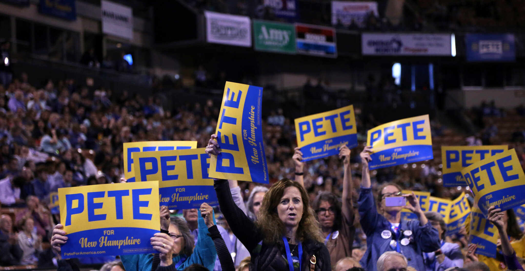 Supporters hold signs for Pete Buttigieg.