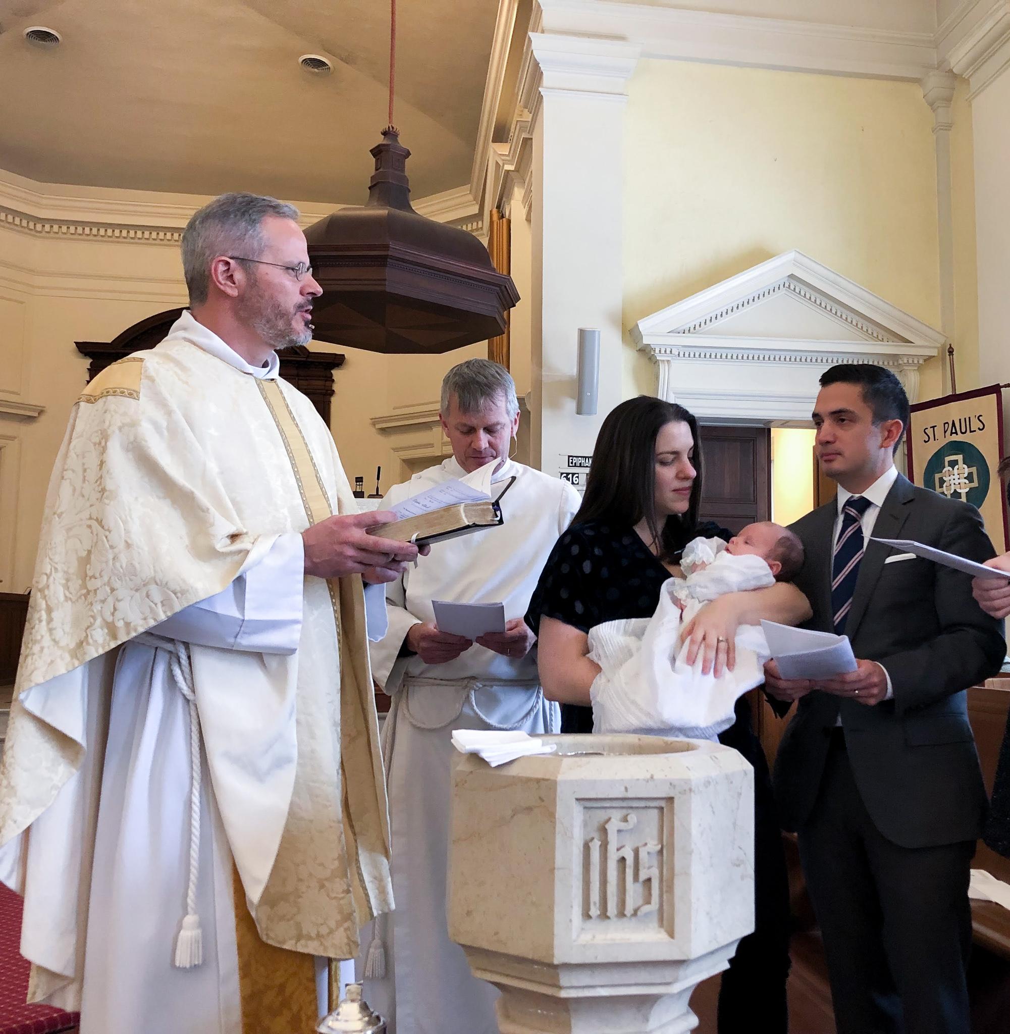 Newborn being baptized at St. Paul's Memorial church.