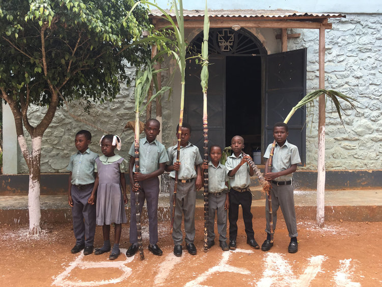Students at Kris Roi Episcopal School in Léger, Haiti welcoming visitors from St. Paul's.