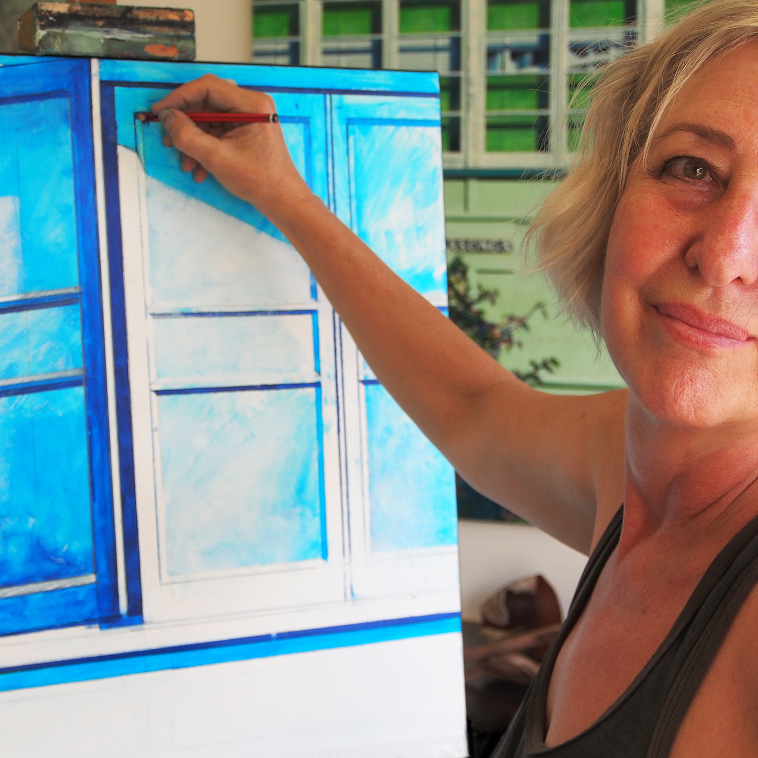 Susan drawing up painting for Sunshine Coast Open House_2019.jpg