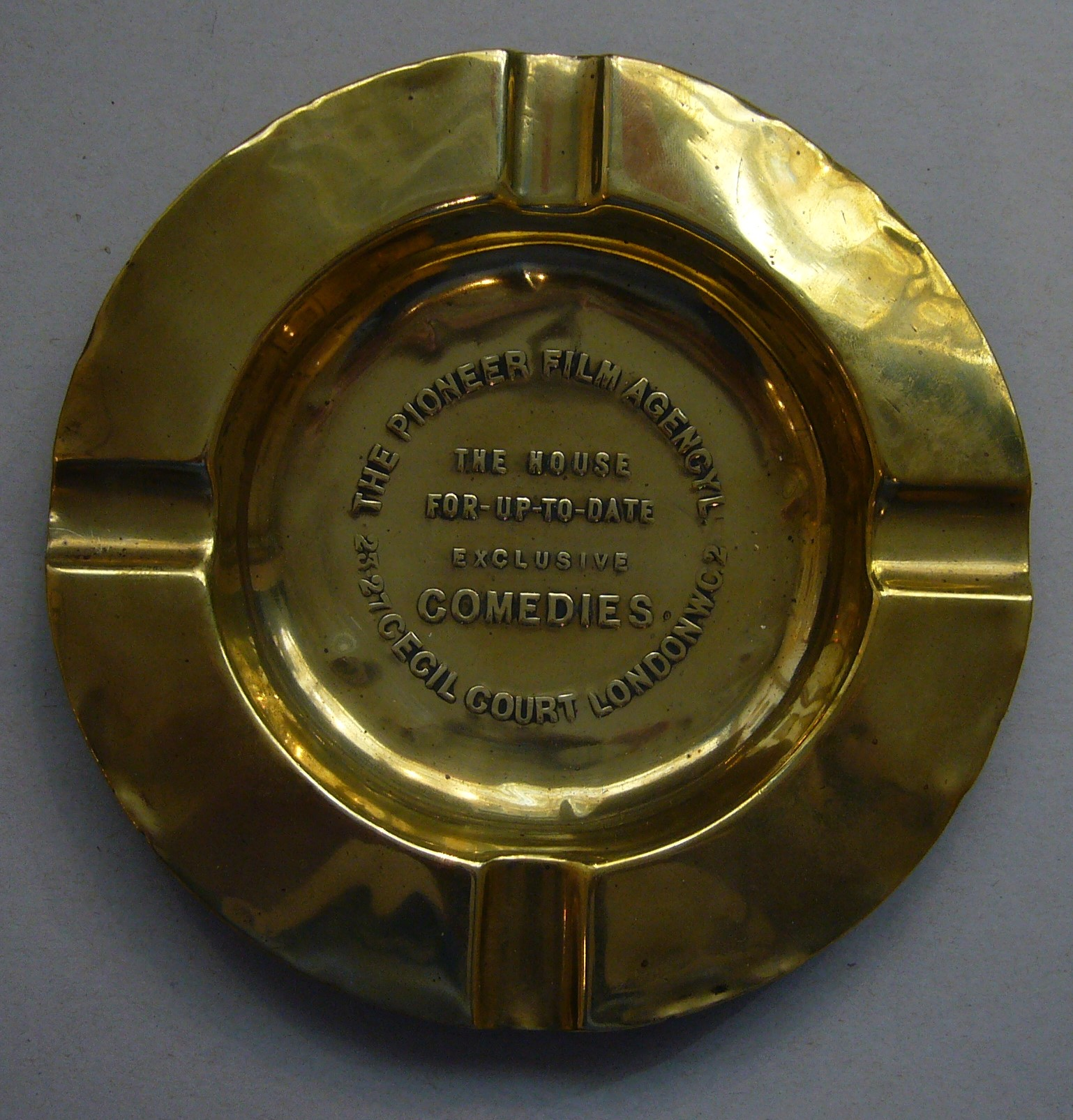 Brass ash-tray made for the Pioneer Film Company, c. 1912
