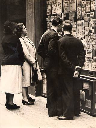 Browsers outside the Stamp Shop at 6 Cecil Court in the 1940s