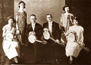 Fisher Shipp Concert Co. banjo ensemble, from left: Crane, Shipp, Loar, Johnstone, Campbell, VerCies. (Loar is playing an MB5 mandolin-banjo and Nell VerCies has Loar's TB5.