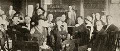 Loar's involvement at Gibson went beyond being acoustical engineer and instrument designer. Here he participates as musicologist in a 1924 sales agent meeting (standing in back of room, center, to right of blackboard). Note the music notation on blackboard; most probably depicting the range of Gibson's instrument line.