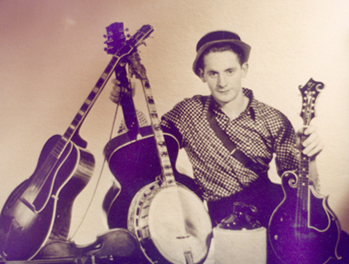 Les Paul's influence on Gibson's development of musical instruments was somewhat similar to Loar's, although Lloyd worked for Gibson (which Les Paul did not). Among other Gibson instruments, young Les is seen here holding a Loar-signed F5 mandolin and two L5 guitars.