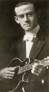 """Loar's tenure with Gibson ended in December 1924. This photograph of Loar with an early pre-truss rod F4 mandolin was one of the last of him that appeared in Gibson catalogs (this from the 1923 """"M"""" catalog)."""