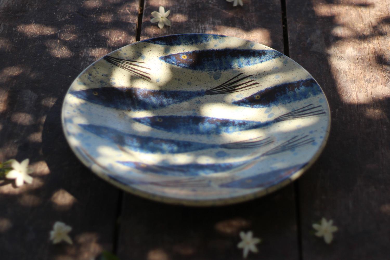 Handmade platter with fish design