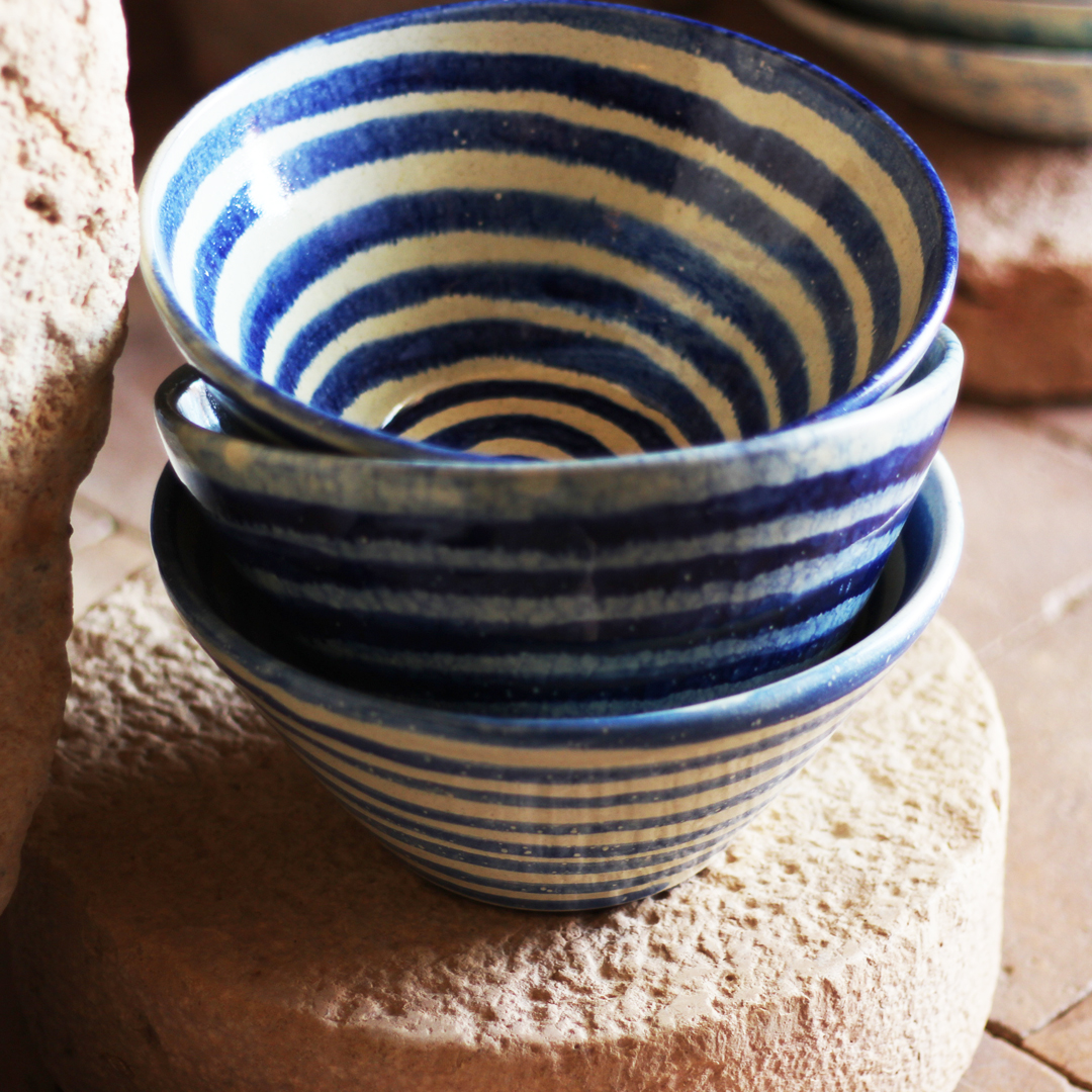 Handthrown bowls with blue spiral lines
