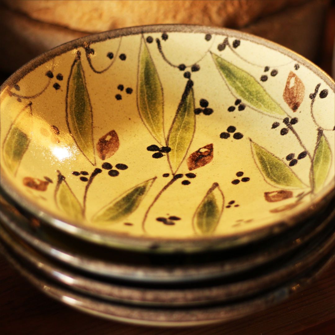 Handmade, hand-painted ceramic dish with olive design