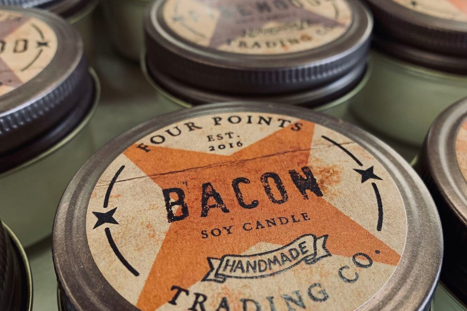 Four Points Trading Co. - Our candles are created with uniquely designed fragrances that have the power to evoke experiences and trigger nostalgic emotions. With every flicker of the flame creating a one of a kind atmosphere that will entice your senses. Every scent tells a story.