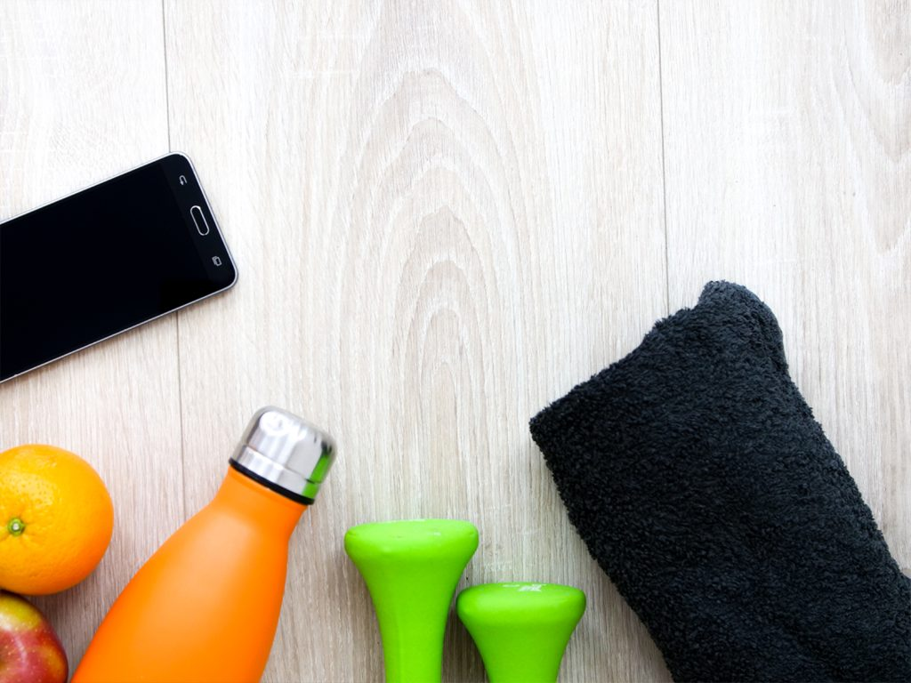 smartphone, weights, fruit, towel and water bottle cutting plan