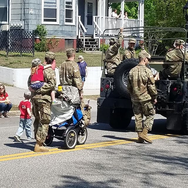 Happy memorial day everyone. I love this woman. She's a multitasking hero.  She is piggybacking and pushing a stroller with a baby in it. She also was keeping close watch on the little boy next to her.  I'm in awe of her. Thank you to all who have served and are currently serving our country.  Today was also a celebration of my city's 150th birthday. I also got a picture of my grandfather's fire engine. :)
