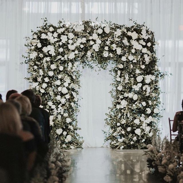 You've got to be archin' kidding me! How gorg is this ceremony piece by @wildflowerdsm • • • #floralinstillation #wildflowerdsm #byinvitationonlyblog #ceremonyfloralarch #weddingplanningdesmoines #bridesofdsm #allthingswedding #floralalterarch #sayingido