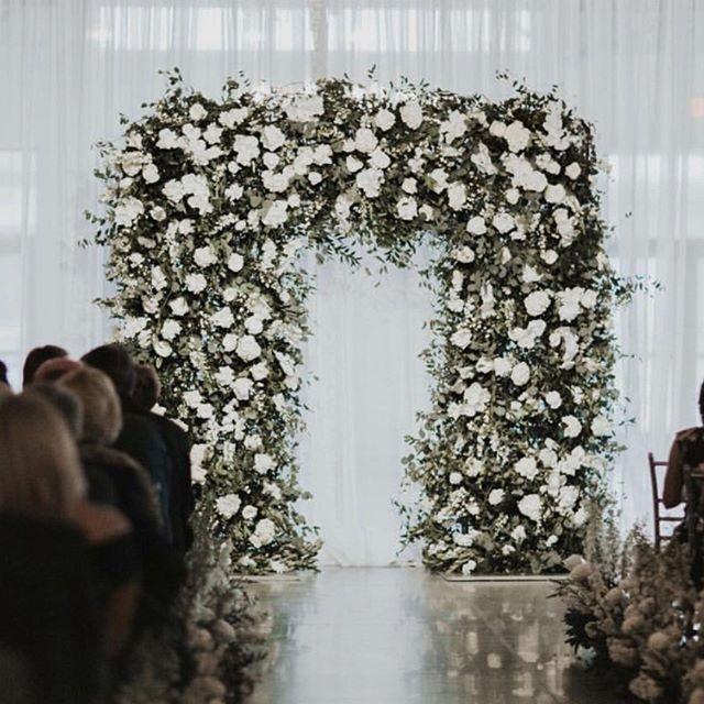 You've got to be archin' kidding me! How gorg is this ceremony piece by @wildflowerdsm • • • #floralinstillation #wildflowerdsm #byinvitationonlyblog #ceremonyfloralarch #weddingplanningdesmoines #bridesofdsm #allthingswedding #floralalterarch #sayingido