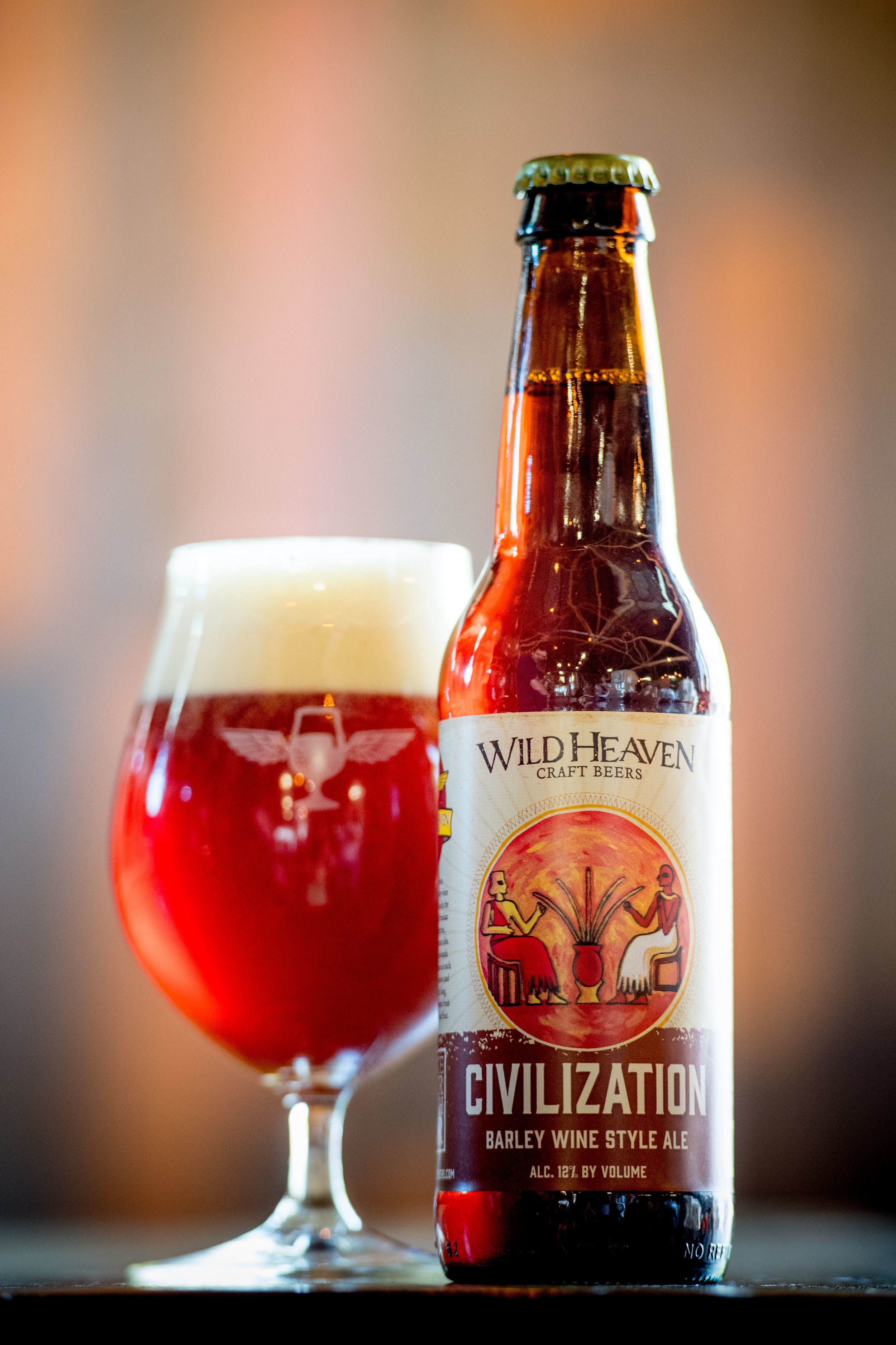 Civilization - English-style Barley Wine Ale12% ABV | 50 IBUCivilization is an English-style barley wine made resplendent with the addition of dried Prussian lemons, tart cherries, cranberries and cocoa nibs. Dark fruit flavor abounds with roasted goodness in each sip with hints of melon and tropical aromas. A long, lingering finish evokes fresh bread and mellow pit fruit.Suggested food pairings: Game, dessert, chocolate, candied fruits.